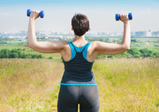 Plus size woman exercising with dumbbells Royalty Free Stock Images