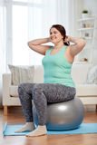 Plus size woman exercising with fitness ball Stock Photo