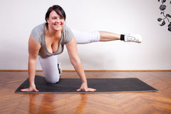 Plus size woman exercising at home Stock Images
