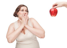 Plus size woman fearing healthy food Royalty Free Stock Photo