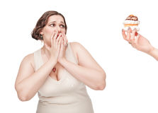 Plus size woman fearing pastry Royalty Free Stock Images