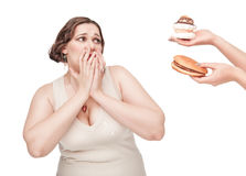 Plus size woman fearing unhealthy food Stock Photo