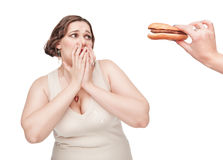 Plus size woman fearing unhealthy food Stock Image
