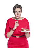 Plus size woman with fork temptating with cake Royalty Free Stock Photography