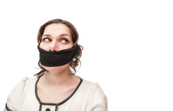 Plus size woman gagged. Beautiful brunette plus size woman gagged isolated stock photo