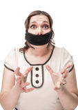 Plus size woman gagged and scared. Beautiful brunette plus size woman gagged and scared isolated royalty free stock image