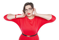 Plus size woman in glasses covering her ears with her hands Stock Photography