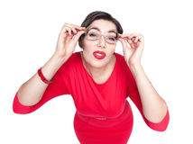 Plus size woman in glasses fixedly looking on you isolated. Top Royalty Free Stock Photo
