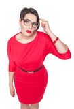Plus size woman in glasses gesturing finger against her temple Royalty Free Stock Photo