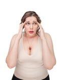 Plus size woman with headache Stock Photo
