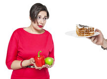 Plus size woman making choice between healthy and unhealthy food Stock Photos