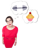 Plus size woman making choice between sport and unhealthy food. Isolated royalty free stock images