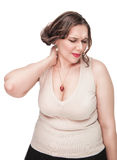 Plus size woman with pain in her neck Royalty Free Stock Image
