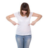 Plus size woman pointing on blank white t-shirt isolated on whit Royalty Free Stock Image