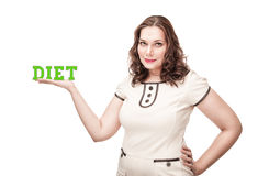Plus size woman presenting word diet on her palm Royalty Free Stock Image