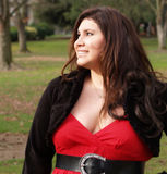 Plus-size woman in red dress. Large woman in autumn outdoor portrait Stock Image