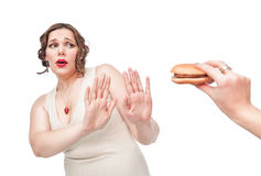 Plus size woman refusing junk food Royalty Free Stock Photography