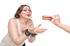 Plus size woman seduced with hamburger Stock Photography