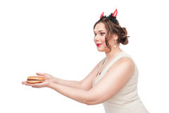 Plus size woman seducing with hamburger Royalty Free Stock Image