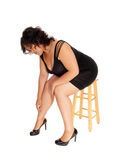 Plus size woman sitting on chair. Stock Image