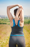 Plus size woman stretching outdoor Royalty Free Stock Image