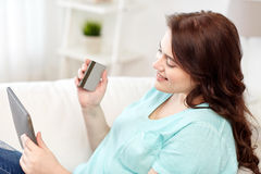 Plus size woman with tablet pc and credit card Stock Photo