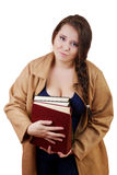 Plus size woman with thick volumes of books. On a white background Stock Photography