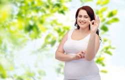 Plus size woman in underwear showing ok hand sign Stock Photo