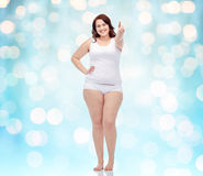 Plus size woman in underwear showing thumbs up Stock Images