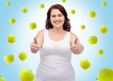 Plus size woman in underwear showing thumbs up Royalty Free Stock Photos