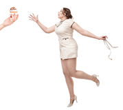 Plus size woman wish for cake with centimeter in hands Stock Photography