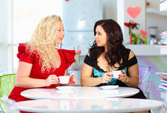 Plus size women sitting in cafe Stock Photography