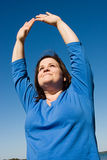 Plus Sized Fitness - Praise. Plus sized woman doing yoga outdoors and offering praise Royalty Free Stock Photography