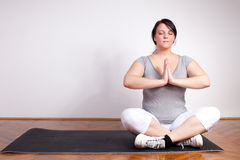 Plus sized woman practising yoga Royalty Free Stock Photo