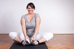 Plus sized woman stretching Royalty Free Stock Image