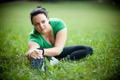 Plus sized woman stretching Stock Photos