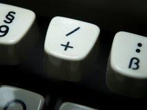 Plus and Slash key on vintage typewriter Royalty Free Stock Image