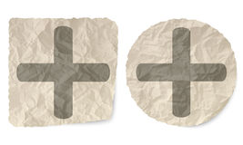Plus symbol. Crumpled slip of paper and a plus symbol Royalty Free Stock Images