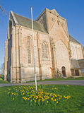 Pluscarden Abbey. Pluscarden Abbey at Easter time with daffodils in bloom. The Abbey is situated in countryside near Elgin, Morayshire Royalty Free Stock Photo