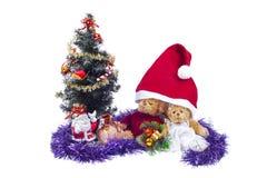Plush bear cubs near an artificial Christmas. Tree with Santa Claus stock image