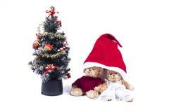Plush bear cubs. Near an artificial Christmas tree stock image