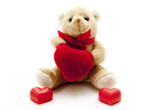Plush bear with dear symbol Stock Photo
