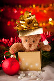 Plush bear in golden present box christmas ornaments with lights Royalty Free Stock Images