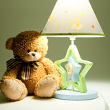 Plush bear and lamp Royalty Free Stock Photography