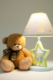 Plush bear and lamp Stock Photography