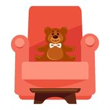 Plush bear on red armchair Royalty Free Stock Photo