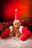 Plush bear with red christmas  gloves and red ball Stock Photo