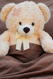 Plush bear sick patient in bed Royalty Free Stock Images