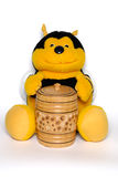 The plush bee with a honey keg. Isolated on white Stock Photography