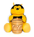 The plush bee with a honey keg. Isolated on white Royalty Free Stock Photo